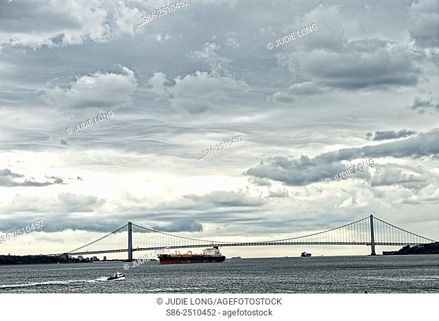 Viewing Oil Tanker Ships Going under the Verrazano Narrows Bridge on their way out to sea. Cloudy Weather