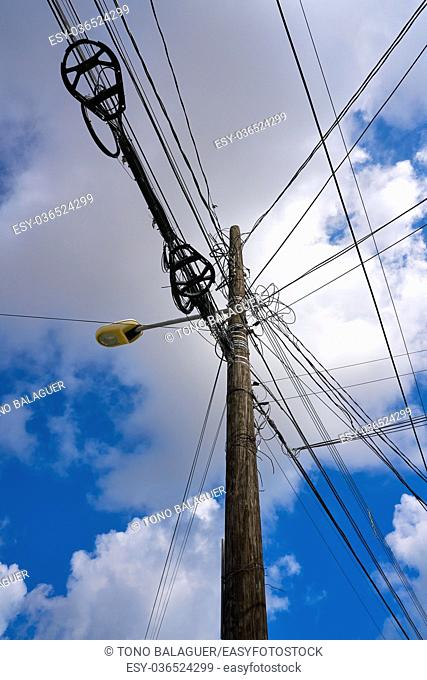 Messy electric aerial wires and pole in Mexico
