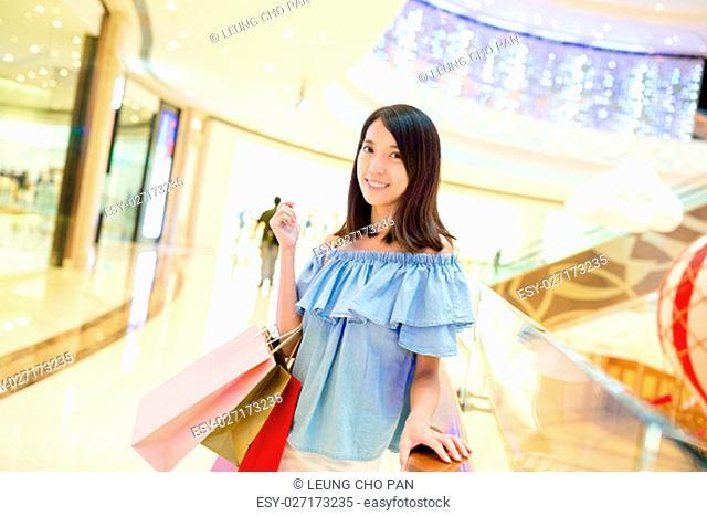 Woman shopping in shopping center