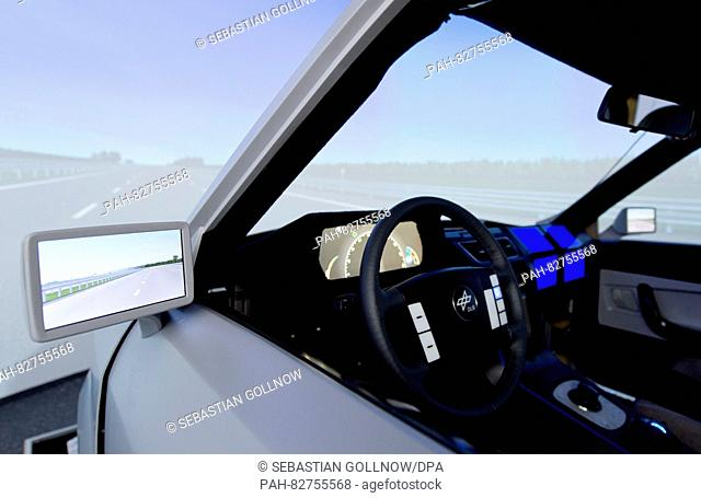 A model car can be seen at the VR driving simulation of the German Aerospace Centre (DLR) in Braunschweig, Germany, 8 August 2016