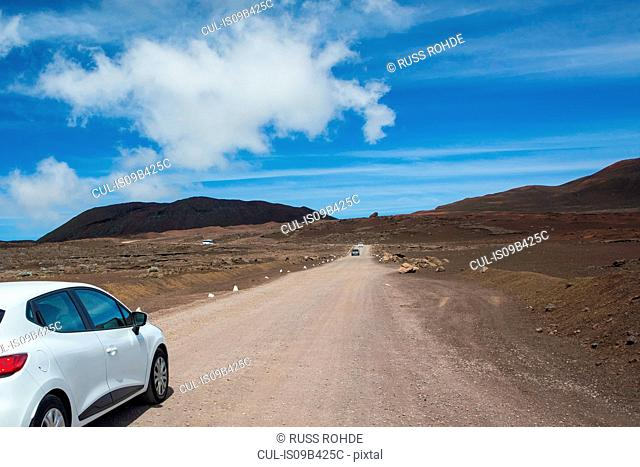 Volcanic landscape with car parked at roadside, Reunion National Park, Reunion Island
