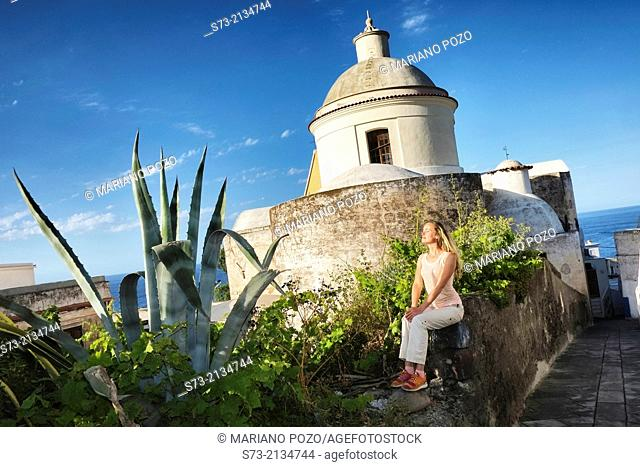 Woman and Stromboli church, Sicily, Italy
