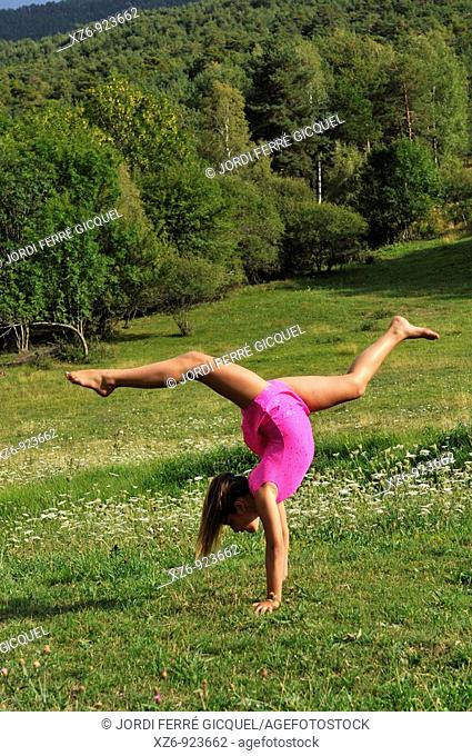 European youth doing gymnastics in a meadow in the Pyrenees