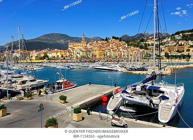 Catamaran by the marina at the old port of Menton, Côte d'Azur, France