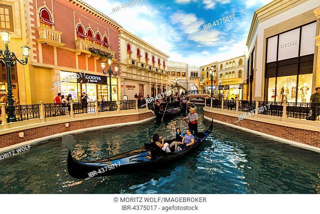 Replica of Venice, tourists in Venetian gondolas on canal, artificial sky, The Venetian Resort Hotel Casino, Las Vegas, Nevada, USA