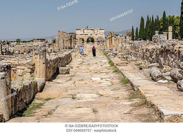 People visit latrine along Frontinus Street at Hierapolis ancient city in Pamukkale, Turkey