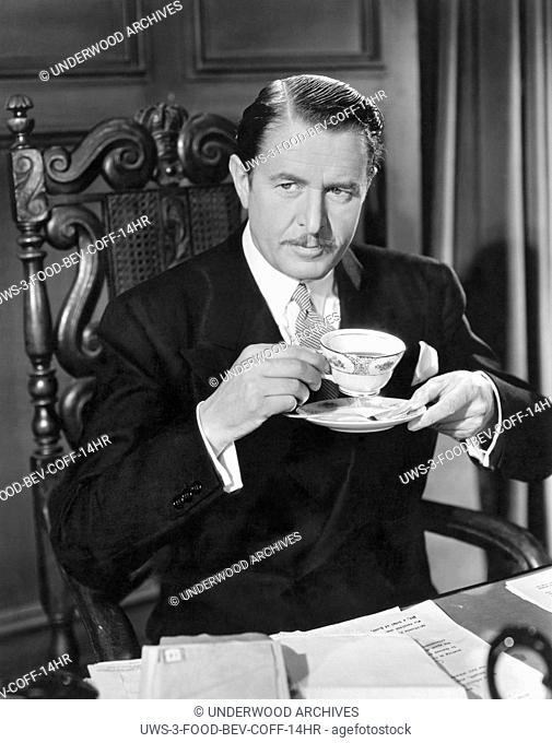 "Hollywood, California: 1937 Reginald Owen has a cup of coffee in the MGM comedy, """"Personal Property"""""""