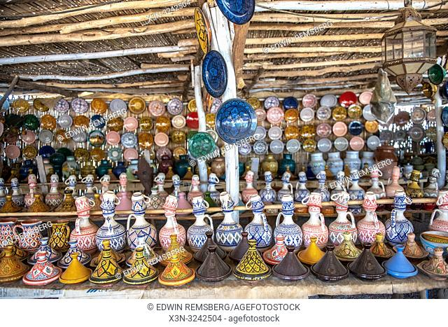 Assorted colorful Tajine pots and pottery for sale at outdoor market, Tangier, Morocco