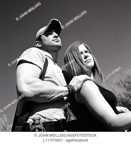Man and woman with rifle; rural