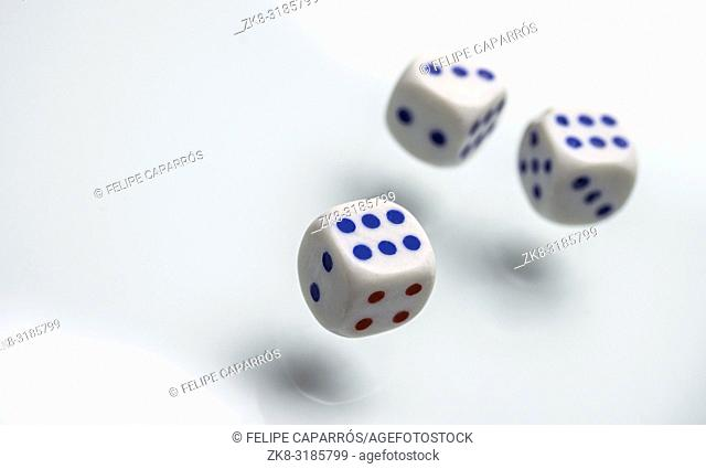 Three dice isolated on white background, conceptual image