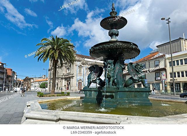 Fountain with lions at Praca de Gomes Teixeira, Igreja do Carmo in background, Porto, Portugal, Europe