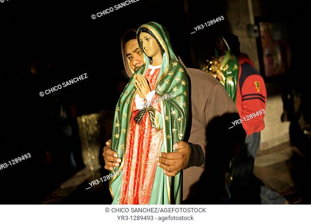 A pilgrim carries a statue of the Our Lady of Guadalupe in Mexico City, December 10, 2010  Hundreds of thousands of Mexican pilgrims converged on the Our Lady...