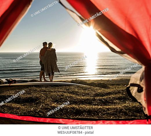 Young couple in love camping at seaside