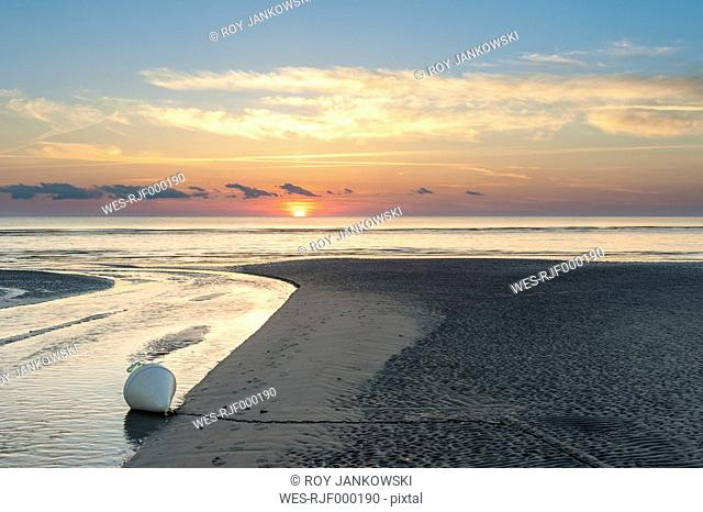 Germany,Schleswig-Holstein, North Sea, Beach of Sankt Peter-Ording in sunset, Buoy