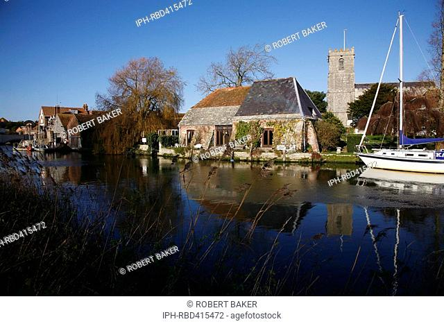Late Autumn view across the River Frome showing the parish church of St Mary's near Wareham Quay