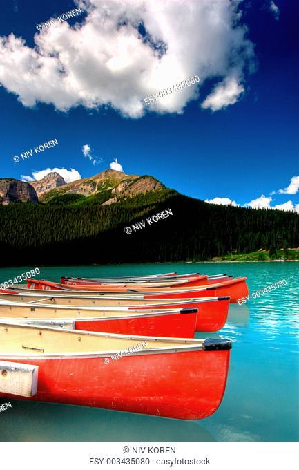 beautiful mountain lake with canoes