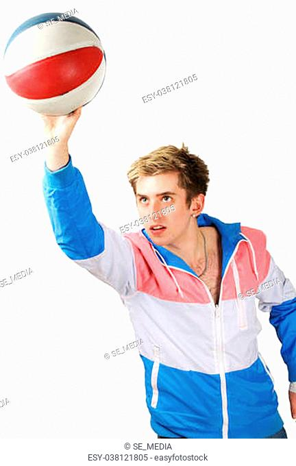 Young handsome basketball player in scoring action