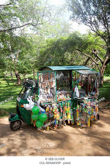 Tuk tuk stall selling toys, snacks and souvenirs, Sri Lanka