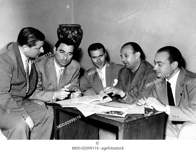 Italian writers Domenico Rea, Nino Stresa, Lino Curci, the Italian director Siro Marcellini and the Italian producer Roberto Amoroso writing the screenplay for...