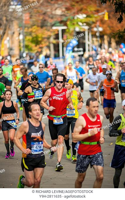 Runners pass through Harlem in New York near the 22 mile mark near Mount Morris Park on Sunday, November 6, 2016 in the 46th annual TCS New York City Marathon