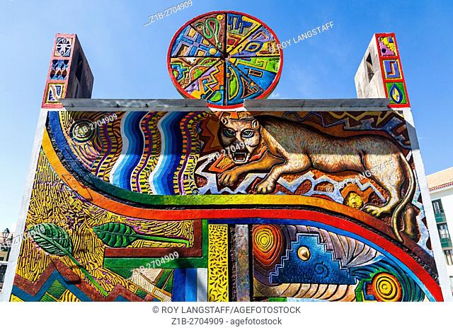 Colourful monument with Incan art at the intersection of Avenue El Sol and Tullumayo Street in Cusco, Peru