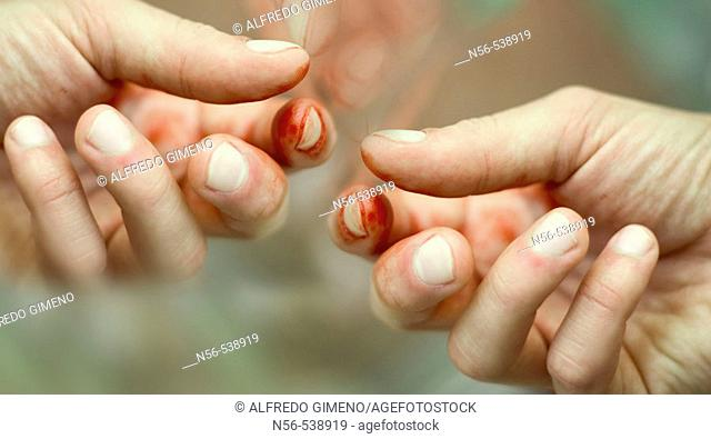 Hands stained  with blood