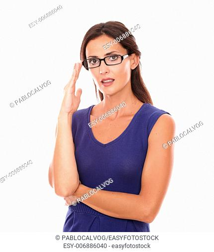 Beautiful girl with spectacles looking at you smiling in white background