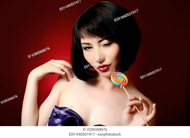 The beautiful girl with a sugar candy
