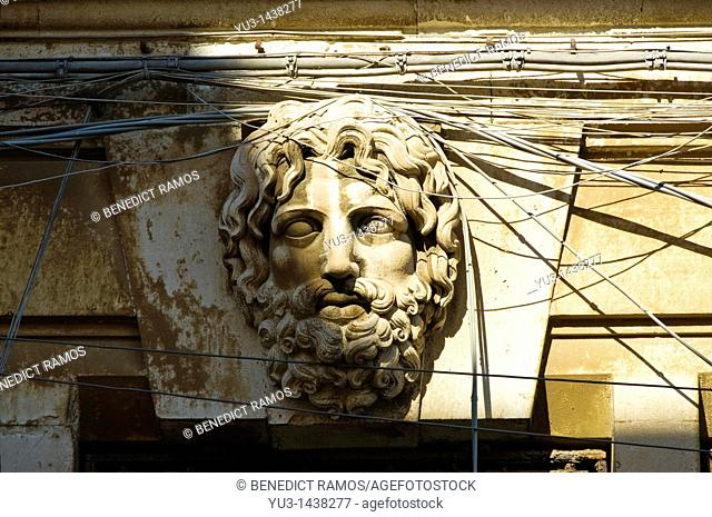 Classical style head and tangle of electrical wires, Siracusa, Sicily