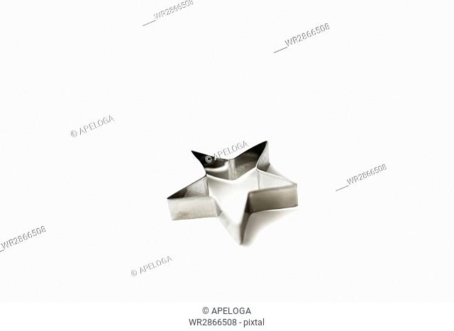 Star shaped cookie cutter on white background