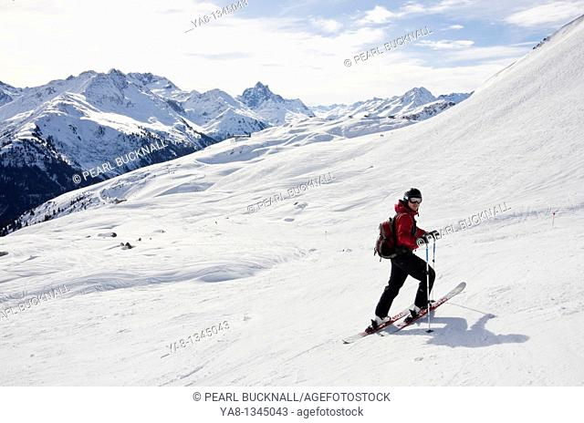 St Anton am Arlberg, Tyrol, Austria, Europe  Skier on ski route 33 from Kapall in Austrian Alps  MR 11/04