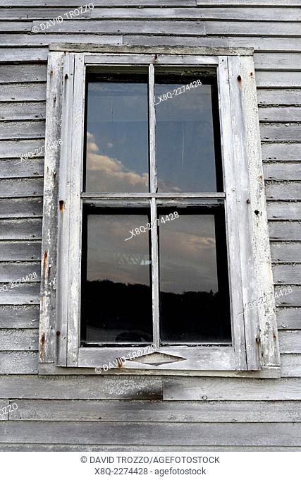 Weather worn window casing on old building in Machais, Maine