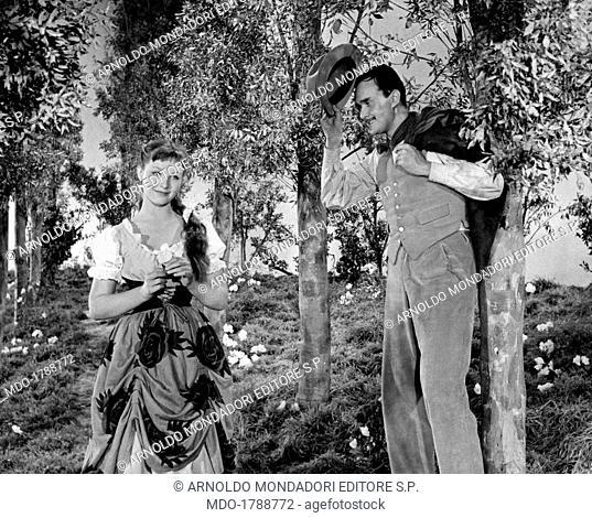 Italian actor and scenarist Galeazzo Benti (Galeazzo Bentivoglio) greeting Russian-born French actress Marina Vlady (Marina Catherine Poljakova) dressed as a...
