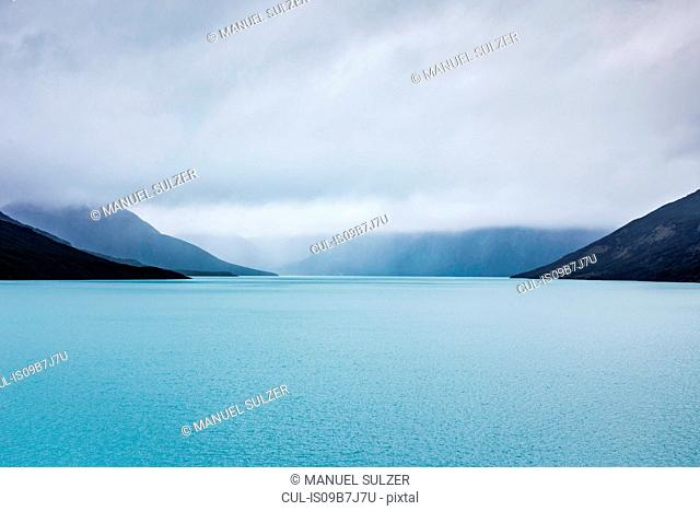 View of low cloud over mountains and lake, Los Glaciares National Park, Patagonia, Chile