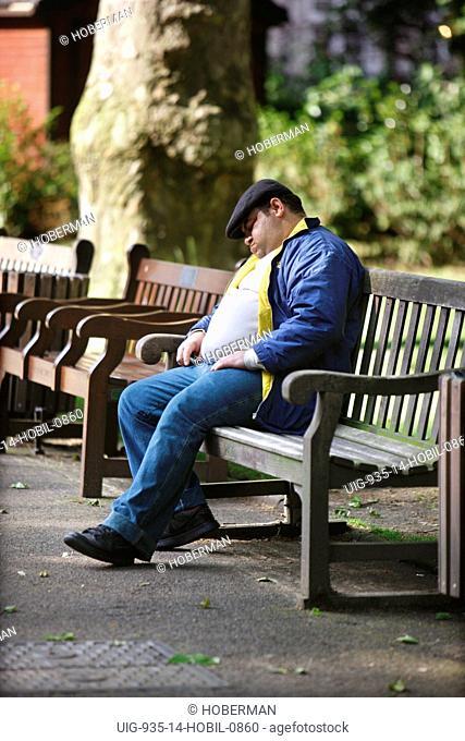 Man Sleeping on a Park Bench, London