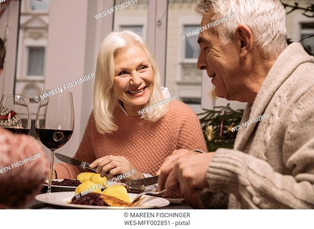 Senior couple having Christmas dinner