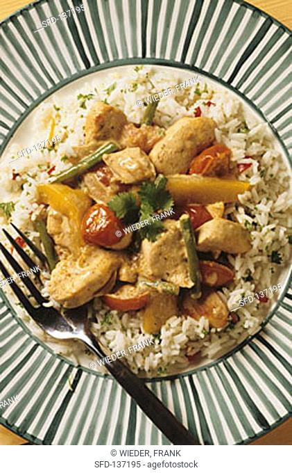 Finely chopped chicken with curried coconut milk sauce