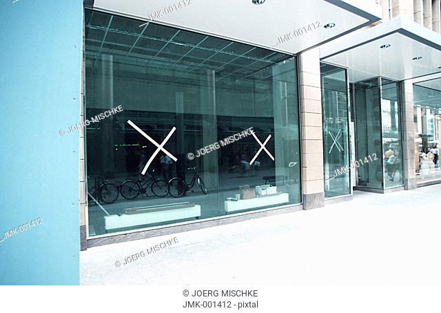 A showcase, shop-window, of an empty shop