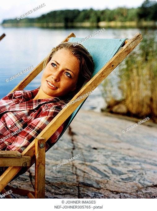 A young woman in a sun chair