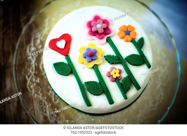 Birthday cake with sugar flowers. Blur