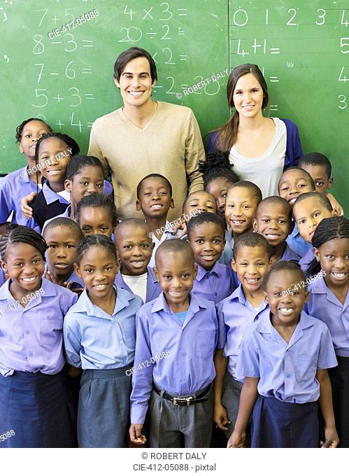 Students and teachers smiling in class