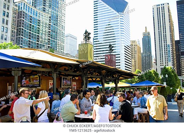 Young professionals socializing after work at Chicago's Park Grill in Millennium Park