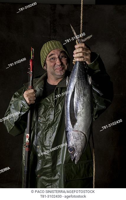 portrait of fisherman with tuna, Spain