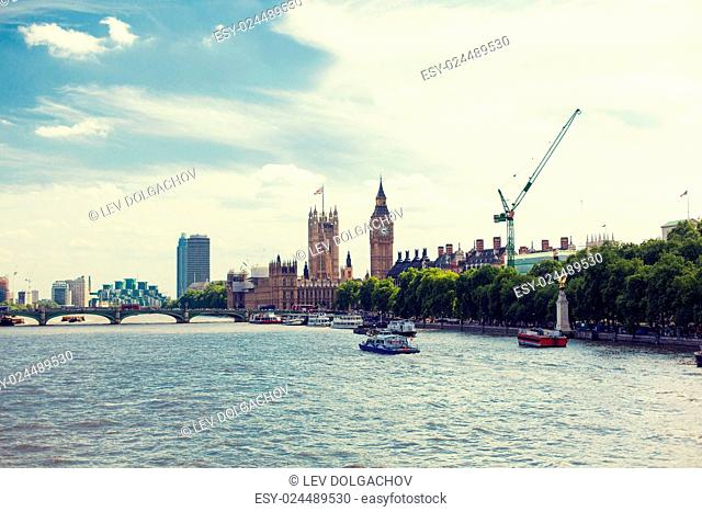 England, London - Big Ben, the Houses of Parliament and Westminster bridge over Thames river