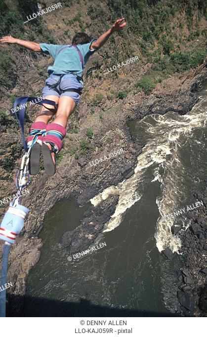 Bungee jumper taking off the Victoria Falls Bridge, Zimbabawe/Zambia