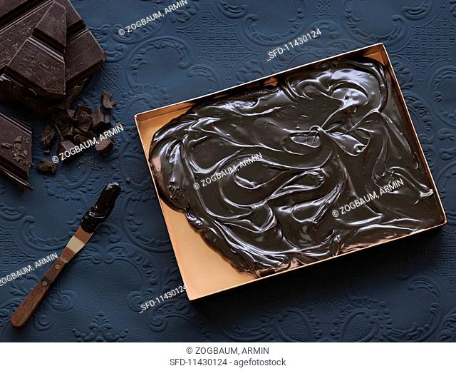 Melted grand cru chocolate on a baking tray