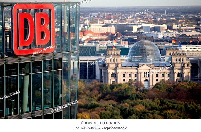 Deutsche Bahn headquarters at Potsdamer Platz with the Reichstag building in the background in Berlin, Germany, 29 October 2013