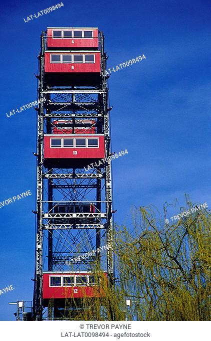 Reisenrad. Ferris wheel. Prater park. Red passenger cabins,gondolas
