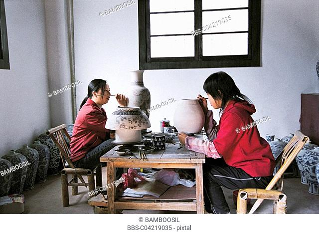 Women workers painting ceramics, Jingde town, Jiangxi Province of People's Republic of China