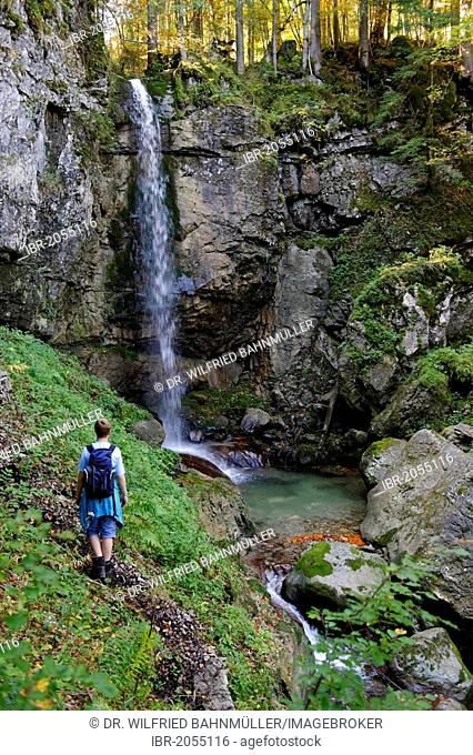 Hiker at Siebli waterfall, Tegernsee Lake region, Valepp, Upper Bavaria, Bavaria, Germany, Europe